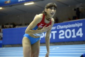 Russia's Ekaterina Koneva celebrates winning the Women Triple Jump Final event at the IAAF World Indoor Athletics Championships in the Ergo Arena in...