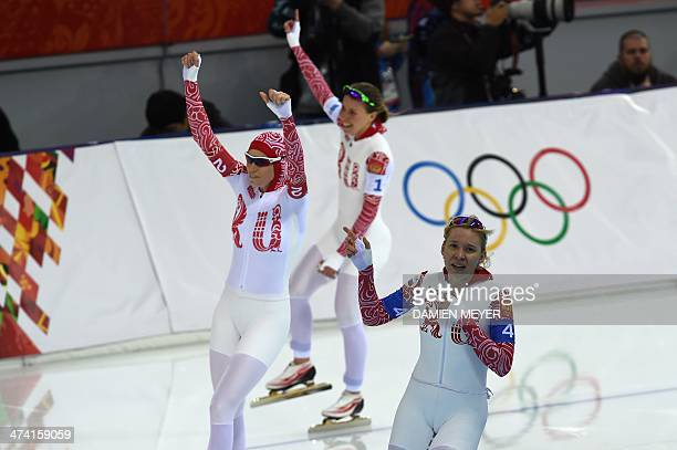 Russia's Ekaterina Lobysheva Russia's Olga Graf and Russia's Yuliya Skokova celebrate after the Women's Speed Skating Team Pursuit Final at the Adler...