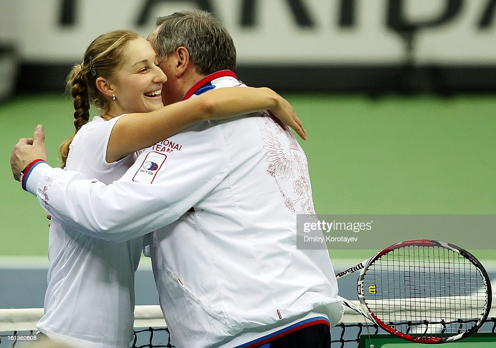 Russia's <a gi-track='captionPersonalityLinkClicked' href=/galleries/search?phrase=Ekaterina+Makarova&family=editorial&specificpeople=2364239 ng-click='$event.stopPropagation()'>Ekaterina Makarova</a> celebrates after winning a doubles match with Elena Vesnina against Japan's Ayumi Morita and Misaki Doi during day two of the Federation Cup 2013 World Group Quarterfinal match between Russia and Japan at Olympic Stadium on February 10, 2013 in Moscow, Russia.