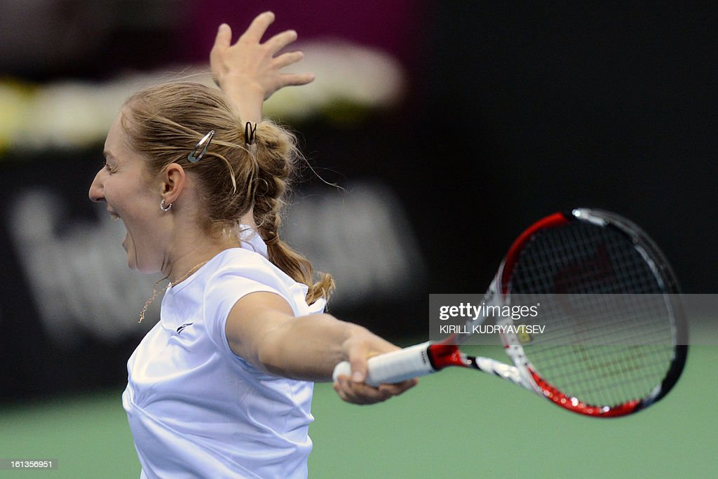 Russia's Ekaterina Makarova celebrates her victory with teammate Elena Vesnina over Japan's Morita Ayumi and Misaki Doi during the International Tennis Federation Fed Cup quarterfinal match between Russia and Japan in Moscow on February 10, 2013. Russia won 3-2. AFP PHOTO/KIRILL KUDRYAVTSEV