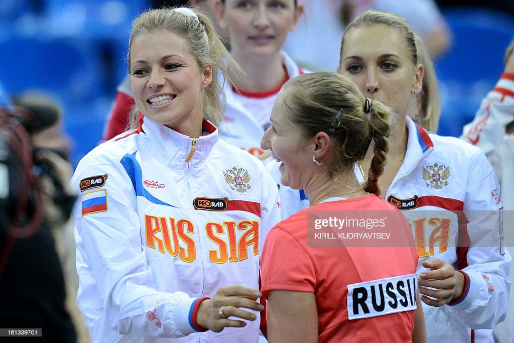 Russia's Ekaterina Makarova (C) is congratulated by teammates Maria Kirilenko (L) and Elena Vesnina after defeating Japan's Kimiko Date-Krumm during the International Tennis Federation Fed Cup quarterfinal match between Russia and Japan in Moscow on February 10, 2013.