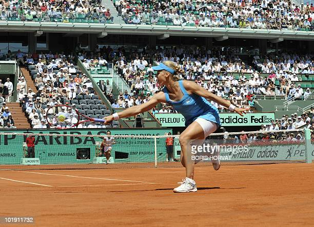 Russia's Elena Dementieva plays a return during her women's semifinal against Italy's Francesca Schiavone in the French Open tennis championship at...