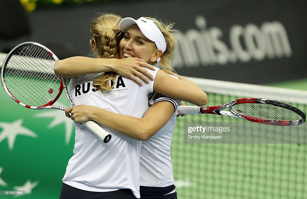 Russia's Elena Vesnina and Ekaterina Makarova celebrate after winning their doubles match against Japan's Ayumi Morita and Misaki Doi during day two of the Federation Cup 2013 World Group Quarterfinal match at Olympic Stadium on February 10, 2013 in Moscow, Russia.