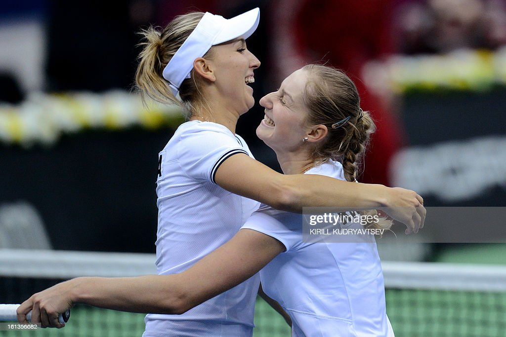 Russia's Elena Vesnina (L) and Ekaterina Makarova celebrate thier victory over Japan's Morita Ayumi and Misaki Doi during the International Tennis Fed Cup quarterfinal match between Russia and Japan in Moscow on February 10, 2013. They won 6-2, 6-2.