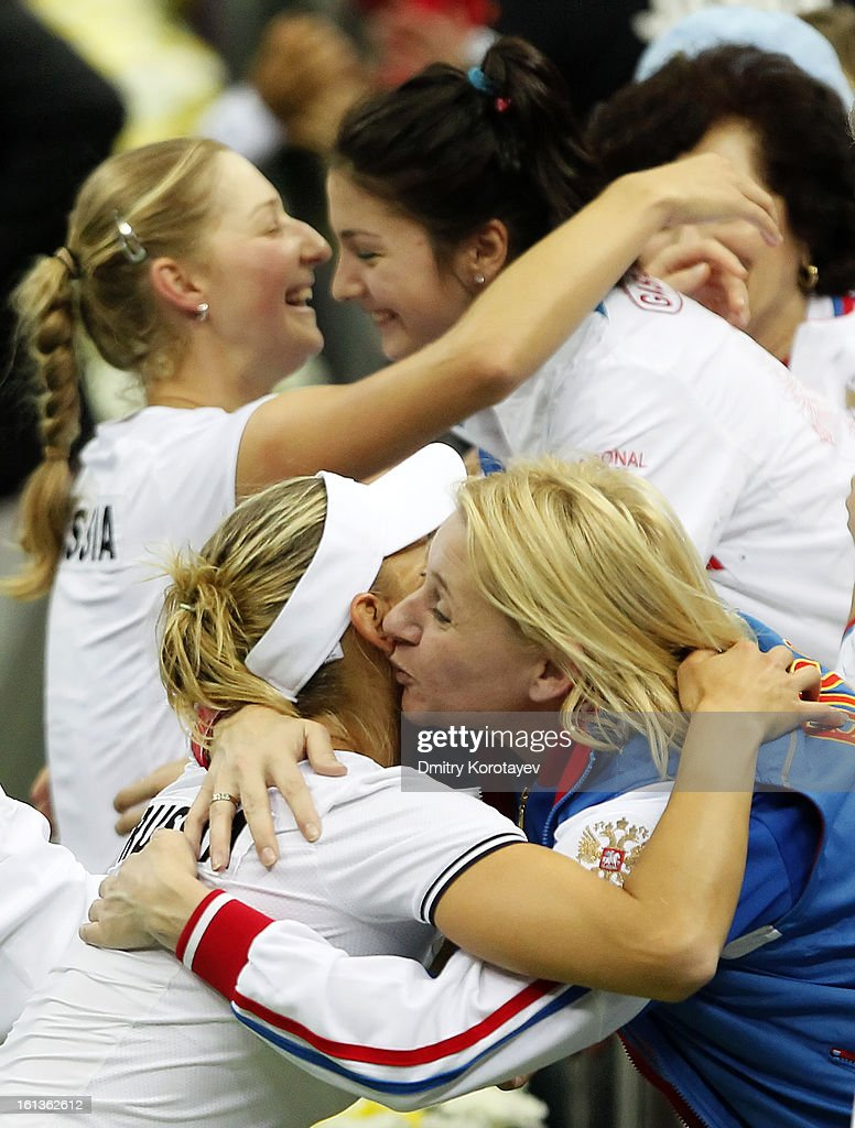 Russia's <a gi-track='captionPersonalityLinkClicked' href=/galleries/search?phrase=Elena+Vesnina&family=editorial&specificpeople=552598 ng-click='$event.stopPropagation()'>Elena Vesnina</a> and <a gi-track='captionPersonalityLinkClicked' href=/galleries/search?phrase=Ekaterina+Makarova&family=editorial&specificpeople=2364239 ng-click='$event.stopPropagation()'>Ekaterina Makarova</a> celebrate with teammates after winning their doubles match against Japan's Ayumi Morita and Misaki Doi during day two of the Federation Cup 2013 World Group Quarterfinal match between Russia and Japan at Olympic Stadium on February 10, 2013 in Moscow, Russia.