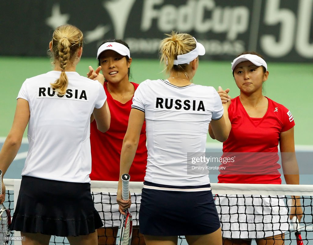 Russia's <a gi-track='captionPersonalityLinkClicked' href=/galleries/search?phrase=Elena+Vesnina&family=editorial&specificpeople=552598 ng-click='$event.stopPropagation()'>Elena Vesnina</a> and <a gi-track='captionPersonalityLinkClicked' href=/galleries/search?phrase=Ekaterina+Makarova&family=editorial&specificpeople=2364239 ng-click='$event.stopPropagation()'>Ekaterina Makarova</a> shake hands with after winning their doubles match against Japan's <a gi-track='captionPersonalityLinkClicked' href=/galleries/search?phrase=Ayumi+Morita&family=editorial&specificpeople=569402 ng-click='$event.stopPropagation()'>Ayumi Morita</a> and <a gi-track='captionPersonalityLinkClicked' href=/galleries/search?phrase=Misaki+Doi&family=editorial&specificpeople=4391508 ng-click='$event.stopPropagation()'>Misaki Doi</a> during day two of the Federation Cup 2013 World Group Quarterfinal match between Russia and Japan at Olympic Stadium on February 10, 2013 in Moscow, Russia.
