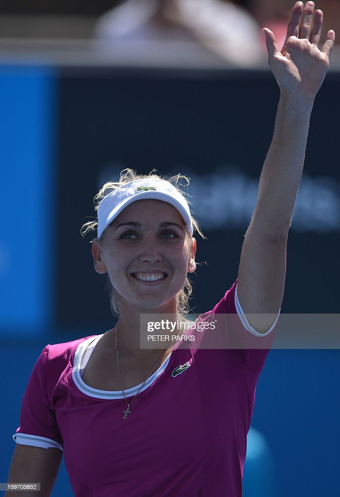 Russia's Elena Vesnina celebrates her victory against Italy's Roberta Vinci during their women's singles match on day six of the Australian Open tennis tournament in Melbourne on January 19, 2013.