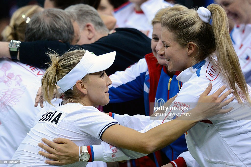Russia's Elena Vesnina (L) congratulates her teammate Maria Kirilenko (R) after she won with Ekaterina Makarova over Japan's Morita Ayumi and Misaki Doi during the International Tennis Federation Fed Cup quarterfinal match between Russia and Japan in Moscow on February 10, 2013. Russia won 3-2. AFP PHOTO/KIRILL KUDRYAVTSEV