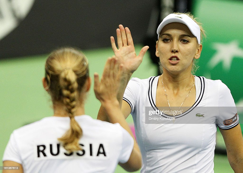 Russia's Elena Vesnina high fives doubles partner Ekaterina Makarova during their match against Japan's Ayumi Morita and Misaki Doi during day two of the Federation Cup 2013 World Group Quarterfinal match at Olympic Stadium on February 10, 2013 in Moscow, Russia.