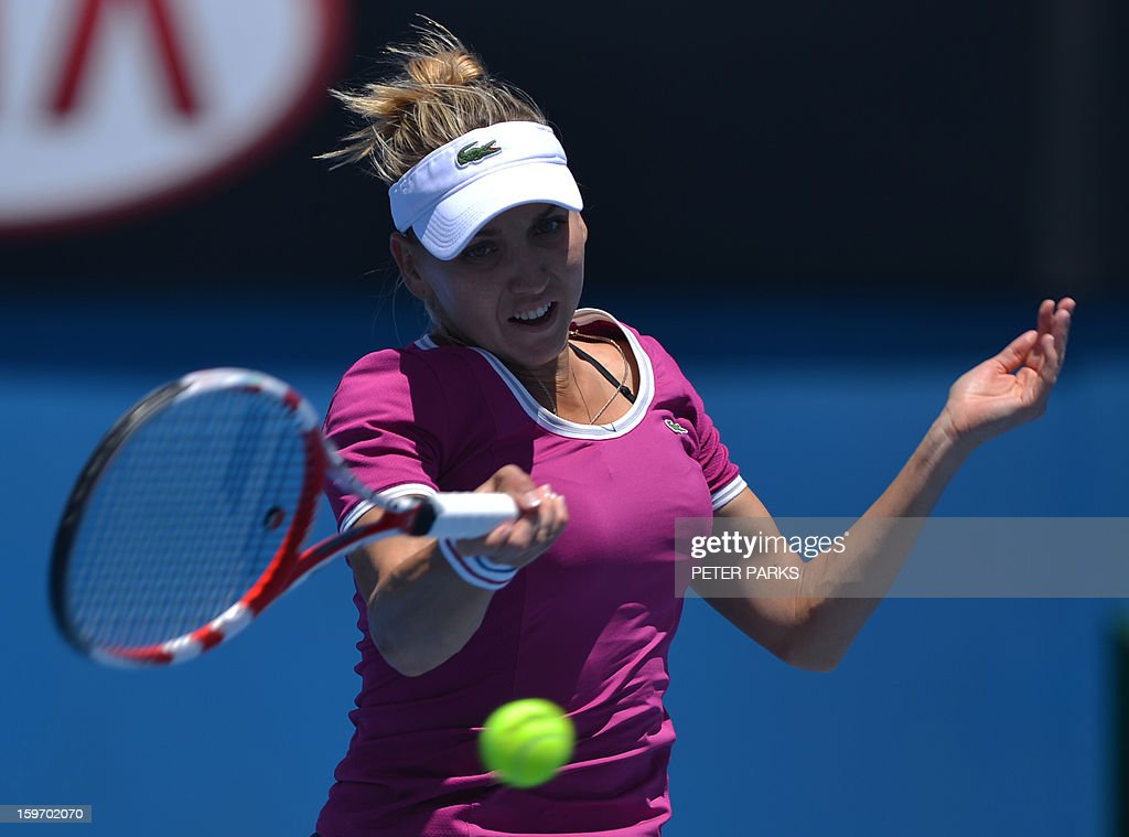 Russia's Elena Vesnina hits a return against Italy's Roberta Vinci during their women's singles match on day six of the Australian Open tennis tournament in Melbourne on January 19, 2013.