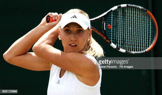 Russia's Elena Vesnina in action against Belgium's Justine Henin during The All England Lawn Tennis Championship at Wimbledon