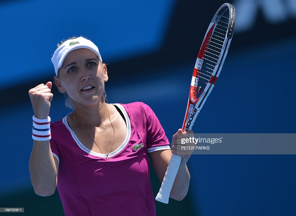 Russia's Elena Vesnina reacts after a point against Italy's Roberta Vinci during their women's singles match on day six of the Australian Open tennis tournament in Melbourne on January 19, 2013.