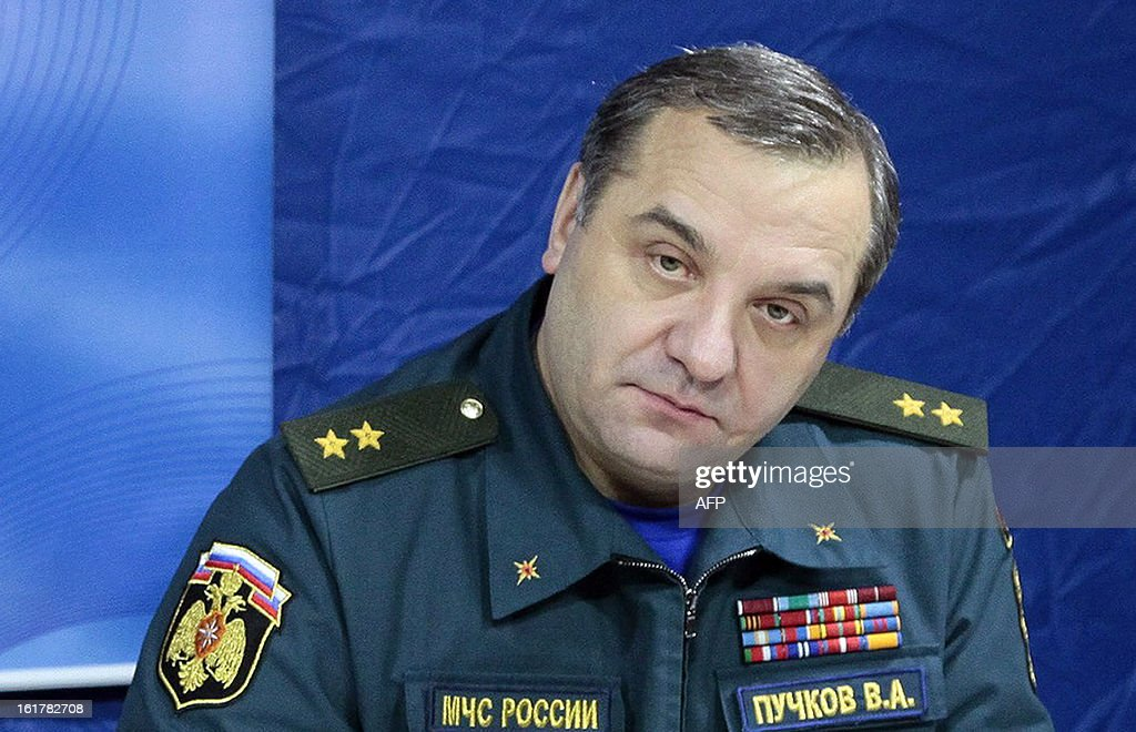 Russia's Emergencies Minister Vladimir Puchkov attends a meeting with journalists in the Urals city of Chelyabinsk, on February 15, 2013, after he inspected the damage caused by a shockwave from a meteor. The unpredicted meteor strike in central Russia that left today hundreds of people injured, left some Russian officials calling for the creation of a global system of space object defence.