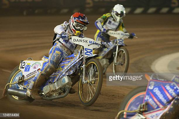 Russia's Emil Sayfutdinov and Poland's Tomasz Gollob compete during the FIM Speedway Grand Prix 2011 at Vojens' Speedway Center on September 10 2011...