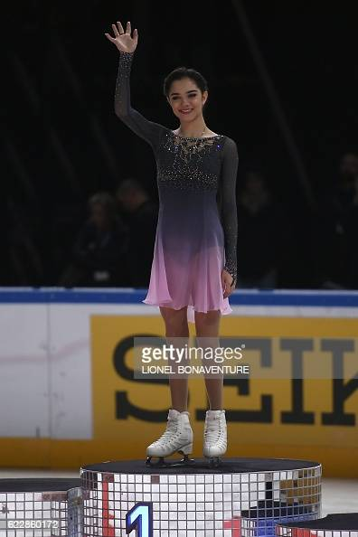 Евгения Медведева - 2 - Страница 45 Russias-evgenia-medvedeva-celebrates-on-the-podium-after-she-won-the-picture-id622860172?s=594x594