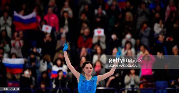 Russia's Evgenia Medvedeva currently ranked 1st celebrates after competing in the womens short program at the ISU World Figure Skating Championships...