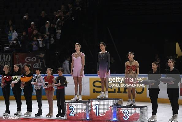 Евгения Медведева - 2 - Страница 45 Russias-evgenia-medvedeva-poses-on-the-podium-with-second-place-picture-id622860354?s=594x594