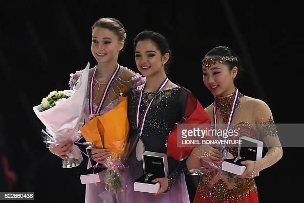 Евгения Медведева - 2 - Страница 45 Russias-evgenia-medvedeva-poses-on-the-podium-with-second-place-picture-id622860436?s=594x594