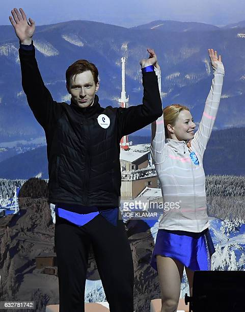 Russia's Evgenia Tarasova and Vladimir Morozov celebrate after the pairs free skating competition of the European Figure Skating Championship in...