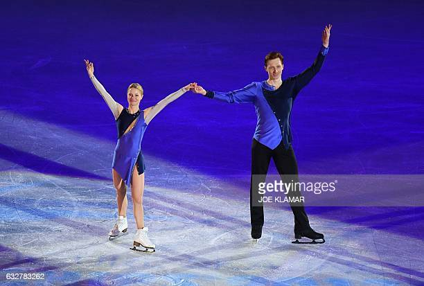 Russia's Evgenia Tarasova and Vladimir Morozov celebrate during the winner's ceremony of the pairs free skating competition of the European Figure...
