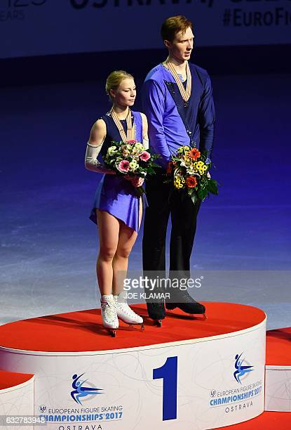 Russia's Evgenia Tarasova and Vladimir Morozov stand on the podium of the winner's ceremony of the pairs free skating competition of the European...