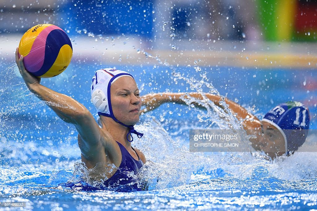 Russia's Evgeniya Ivanova and Italy's Aleksandra Cotti vie for the ball during their Rio 2016 Olympic Games women's water polo semifinal game at the...
