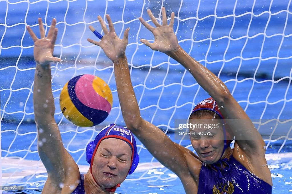 Russia's Evgeniya Ivanova and Russia's Anna Karnaukh can't save a goal against Hungary during their Rio 2016 Olympic Games waterpolo Bronze medal...