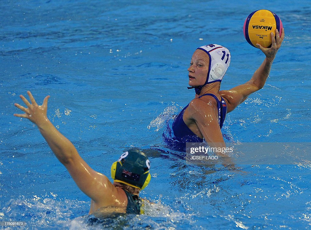 Russia's Evgeniya Ivanova vies with Australia's Glencora McGhie during their women's water polo semifinals match at the FINA World Championships at...
