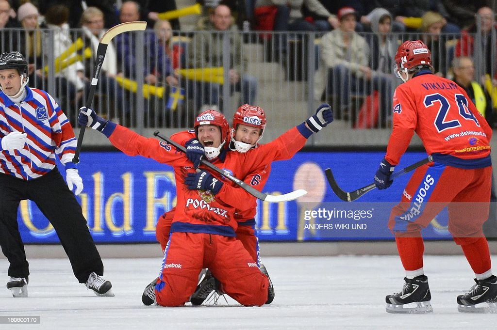 Russia's Evgeny Ivanushkin (L) is congratulated by Yury Shardakov (2nd L) after the 3-1 goal during the Bandy World Championship final match Sweden vs Russia in Vanersborg, Sweden, February 3, 2013.