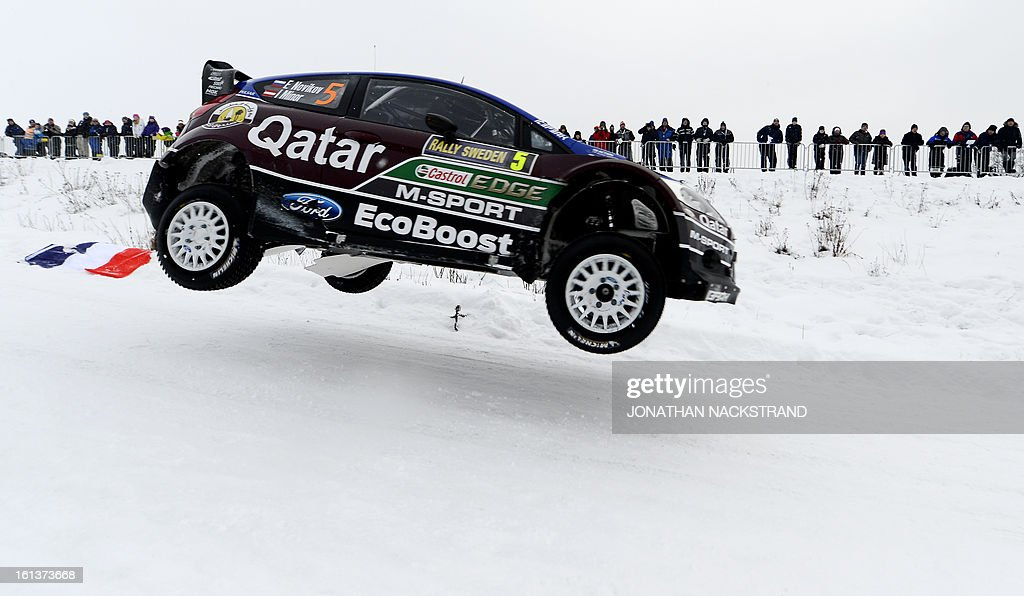 Russia's Evgeny Novikov and his co-driver Ilka Minor steer their Ford Fiesta RS WRC during Kirkenaer stage, the 19th of Rally Sweden, second round of the FIA World Rally Championship on February 10, 2013 in Kirkenaer, Norway.