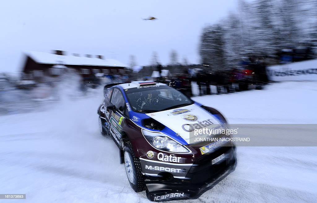 Russia's Evgeny Novikov and his co-driver Ilka Minor steer their Ford Fiesta RS WRC during Mitandersfors stage, the 17th of Rally Sweden, second round of the FIA World Rally Championship on February 10, 2013 in Kirkenaer, Norway.