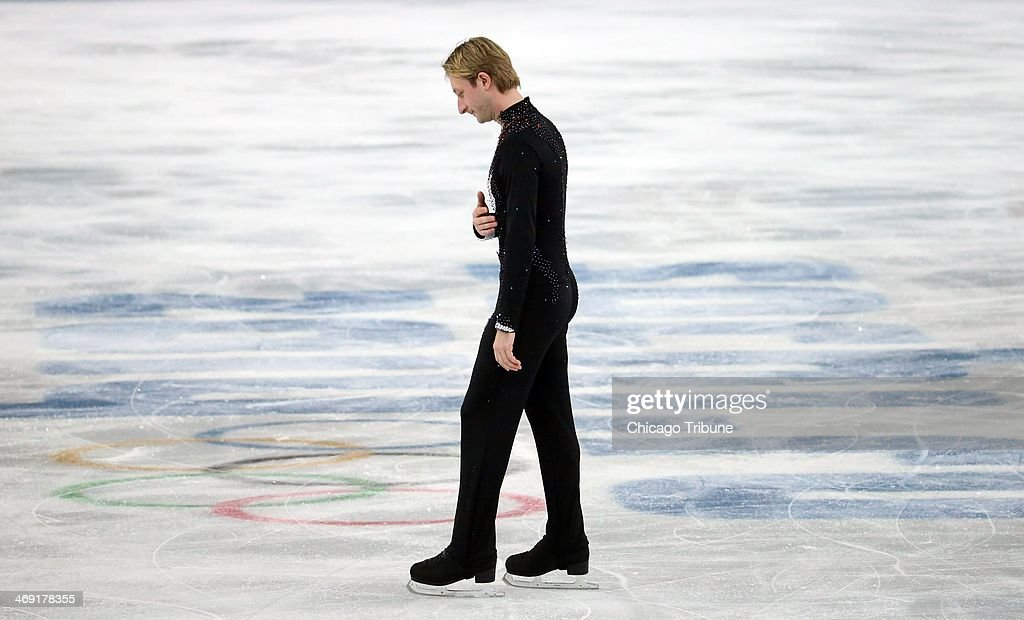 Russias Evgeny Plushenko withdraws from the men's short program figure skating at the Iceberg Skating Palace during the Winter Olympics in Sochi, Russia, Thursday, Feb. 13, 2014.