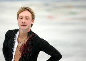 Russias Evgeny Plushenko withdraws from the men's short program figure skating at the Iceberg Skating Palace during the Winter Olympics in Sochi...