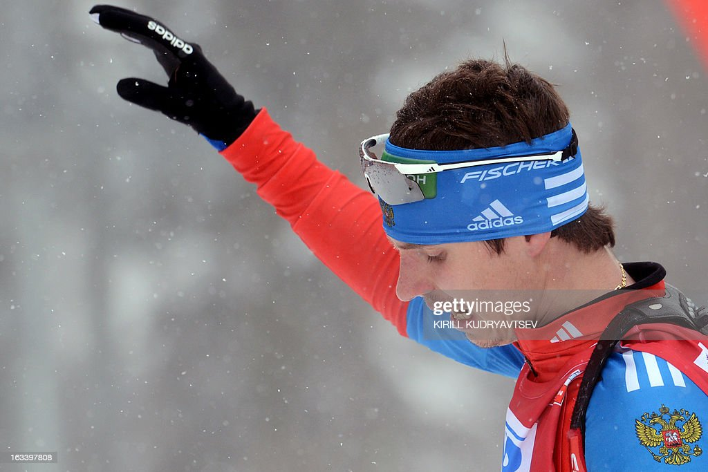 Russia's Evgeny Ustyugov reacts after the Men 7,5 km Sprint during IBU World Cup Biathlon at Laura Cross Country and Biathlon Center in Russian Black Sea resort of Sochi on March 9, 2013. France's Martin Fourcade took the first place ahead of Ustyugov and Norway's Henrik L'Abee-Lund. AFP PHOTO/KIRILL KUDRYAVTSEV