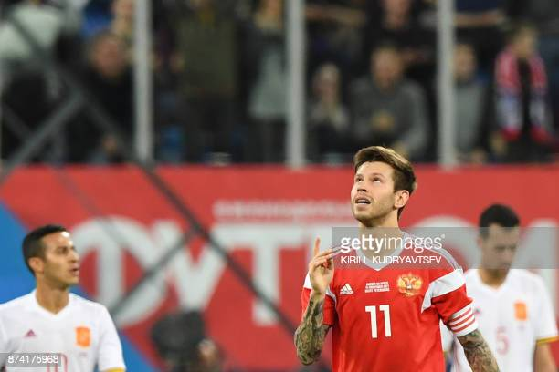 Russia's Fedor Smolov celebrates after scoring a goal during an international friendly football match between Russia and Spain at the Saint...