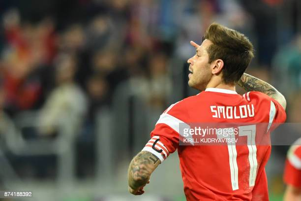 Russia's Fedor Smolov celebrates after scoring the team's third goal during an international friendly football match between Russia and Spain at the...