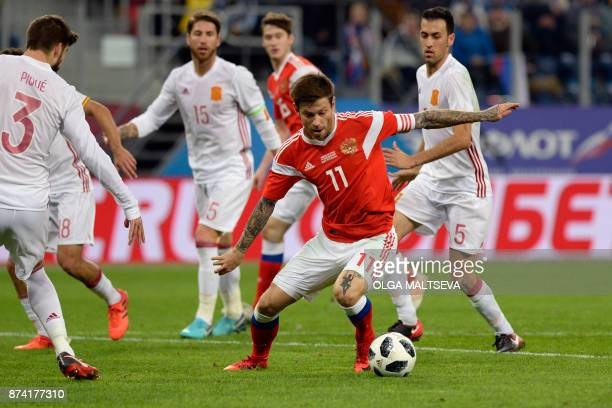 Russia's Fedor Smolov controls the ball during an international friendly football match between Russia and Spain at the Saint Petersburg Stadium in...