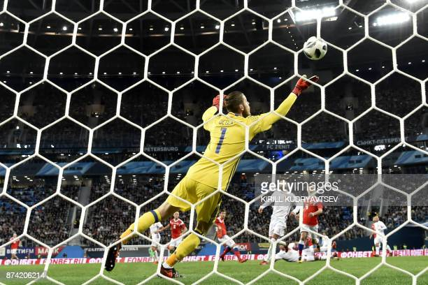 Russia's Fedor Smolov scores during an international friendly football match between Russia and Spain at the Saint Petersburg Stadium in Saint...