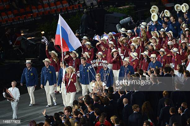 Russia's flagbearer Maria Sharapova leads her country's delegation parade during the opening ceremony of the London 2012 Olympic Games on July 27...