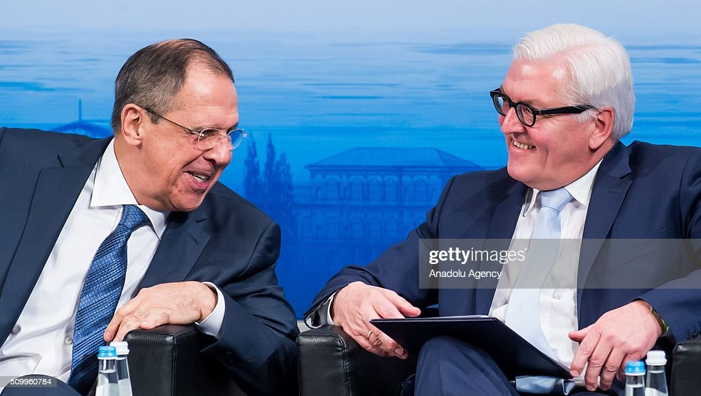 Russia's Foreign Minister Sergei Lavrov (L) speaks with German Foreign Minister Frank-Walter Steinmeier at the 2016 Munich Security Conference at the Bayerischer Hof hotel on February 13, 2016 in Munich, Germany. The annual event brings together government representatives and security experts from across the globe and this year the conflict in Syria will be the main issue under discussion.