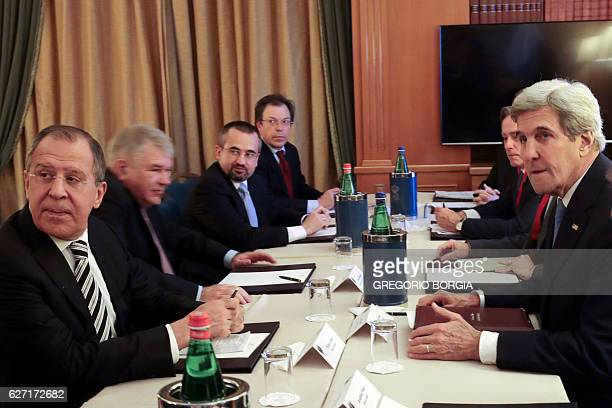 Russia's Foreign Minister Sergei Lavrov speaks with US Secretary of State John Kerry on the sidelines of the Mediterranean Dialogues summit a...