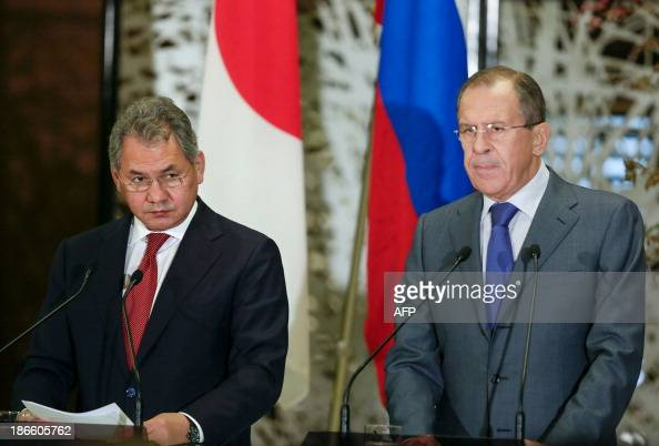 Russia's Foreign Minister Sergey Lavrov and Defence Minister Sergei Shoigu attend a joint news conference with Japan's Foreign Minister Fumio Kishida...
