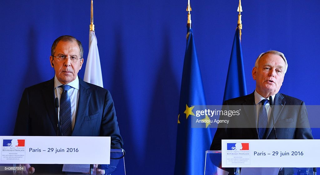 Russia's Foreign Minister Sergey Lavrov (L) and French Foreign Minister Jean-Marc Ayrault (R) hold a press conference after their meeting in Paris, France on June 29, 2016.