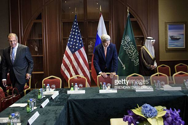 Russia's Foreign Minister Sergey Lavrov US Secretary of State John Kerry and Saudi Foreign Minister Adel alJubeir take their seats before a...