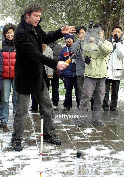 Russia's former tennis world number one Marat Safin tries his skills at miniature tennis during a visit to the Temple of Heaven in Beijing 26...