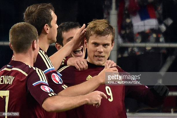 Russia's forward Aleksandr Kokorin celebrates with teammates after scoring a goal during the UEFA Euro 2016 group G qualifying football match between...