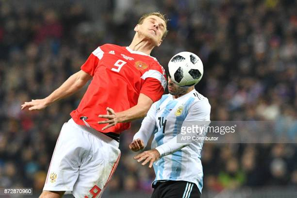 Russia's forward Alexander Kokorin and Argentina's Javier Mascherano vie for the ball during an international friendly football match between Russia...