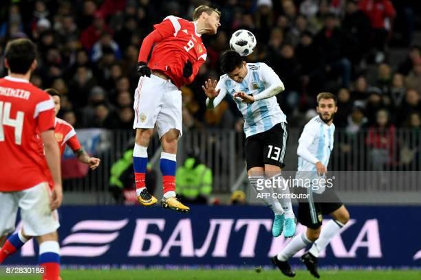 Russia's forward Alexander Kokorin and Argentina's Matias Kranevitter vie for the ball during an international friendly football match between Russia...