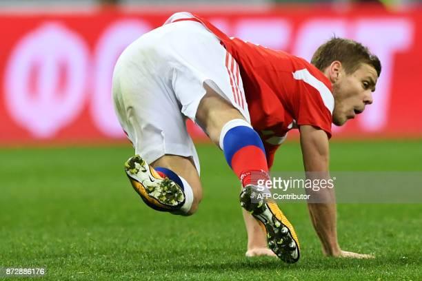 Russia's forward Alexander Kokorin falls during an international friendly football match between Russia and Argentina at the Luzhniki stadium in...