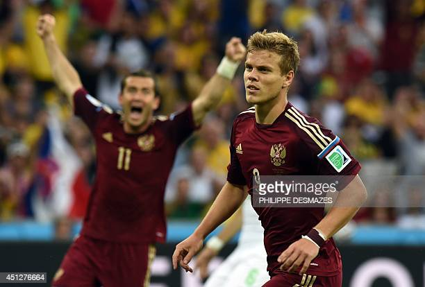 Russia's forward Alexander Kokorin is joined by teammate Russia's forward Alexander Kerzhakov as he celebrates after scoring during the Group H...
